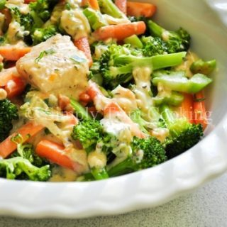 Fish in white sauce with vegetables